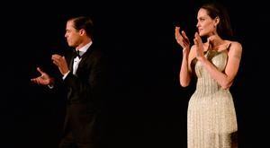 Brad Pitt (L) and Angelina Jolie speak onstage during the opening night gala premiere of Universal Pictures'