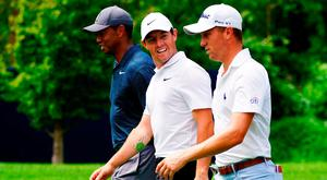 Tiger Woods, Rory McIlroy and Justin Thomas walk on the eighth hole during the first round of the 2018 PGA Championship at Bellerive Country Club