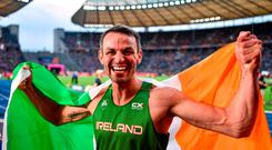 Thomas Barr celebrates with the tricolour after winning bronze in the 400m hurdles at the European Championships in Berlin. Photo: Sam Barnes/Sportsfile