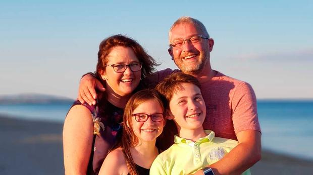 Ben Blackwell (13) with his parents Natalie and James and his sister Sam