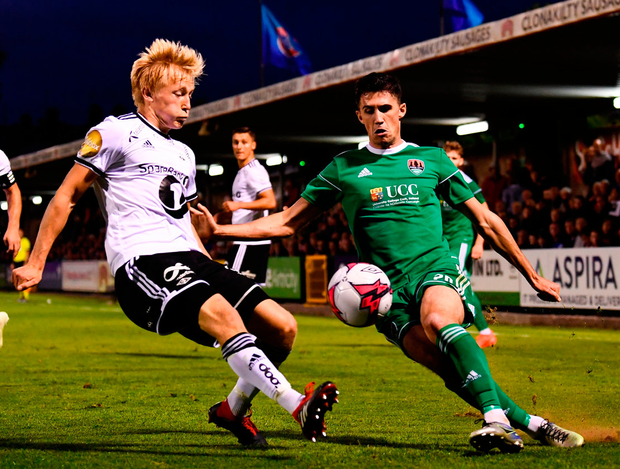 Shane Griffin of Cork City in action against Birger Meling of Rosenborg. Photo: Stephen McCarthy/Sportsfile