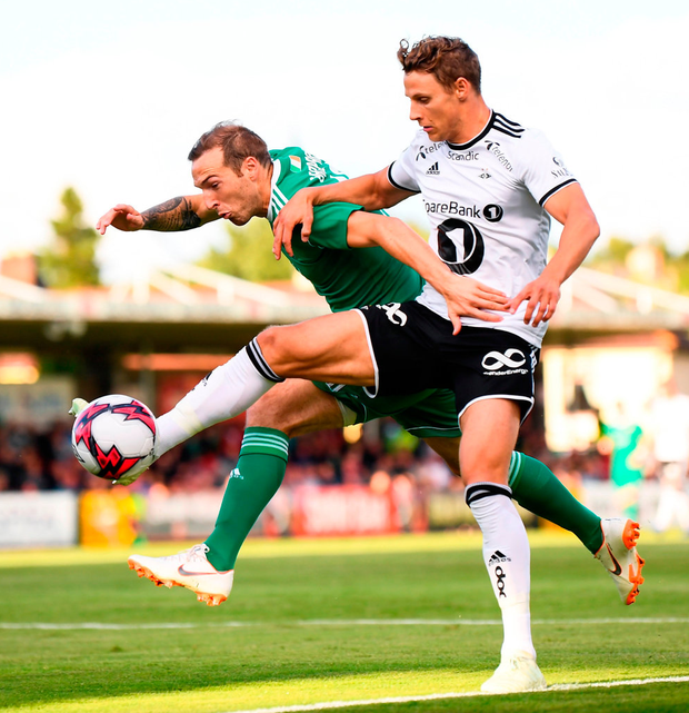Karl Sheppard of Cork City in action against Vegar Hedenstad of Rosenborg. Photo: Stephen McCarthy/Sportsfile