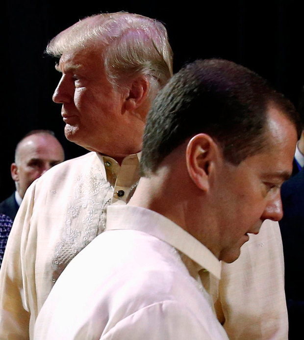 Russia's Prime Minister Dmitry Medvedev crosses paths with Mr Trump during a social event in Manila Photo: REUTERS/Jonathan Ernst