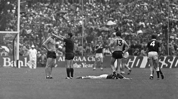 Dublin's Brian Mullins is sent off by referee Sean McKeogh as a Galway player lies on the ground in 1983