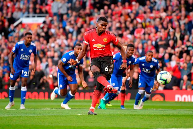 Paul Pogba of Manchester United scores his team's first goal