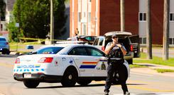 A police officer blocks the area of a shooting in Fredericton, New Brunswick, Canada on Friday, Aug. 10 (Keith Minchin/The Canadian Press via AP)