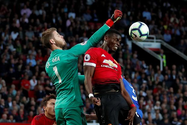 Manchester United's Paul Pogba and David De Gea rise for the ball. Photo: Reuters