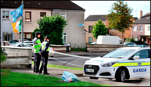 Gardai at the scene of the gun attack at Shangan Green