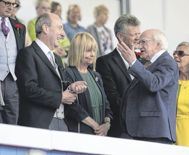 President Michael D Higgins speaking to Transport Minister Shane Ross before the start of Nations Cup at the Dublin Horse Show yesterday. Photo: Damien Eagers