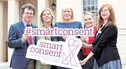 Higher Education Minister Mary Mitchell O'Connor (centre) with Dr Pádraid MacNeela, Dr Siobhán O'Higgins, Kate Dawson and Dr Charlotte McIvor of the Smart Consent Team. Picture: Maxwells
