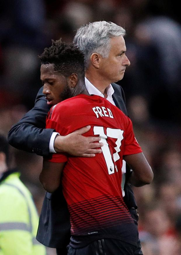 Jose Mourinho embraces Fred after substituting the Brazilian at Old Trafford last night. Photo: Reuters