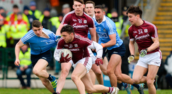 Damien Comer of Galway makes a break from Emmet O'Conghaile, left, and James McCarthy of Dublin
