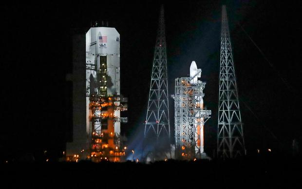 A Delta IV rocket, carrying the Parker Solar Probe, stands on launch complex 37 after the launch was scrubbed at the Kennedy Space Center (AP Photo/John Raoux)