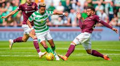 Celtic's Scott Sinclair and Hearts' Jake Mulraney compete for the ball during the Ladbrokes Scottish Premiership match at Tynecastle Stadium, Edinburgh.