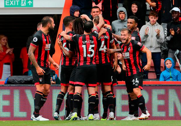 Bournemouth's Callum Wilson is mobbed by his team-mates