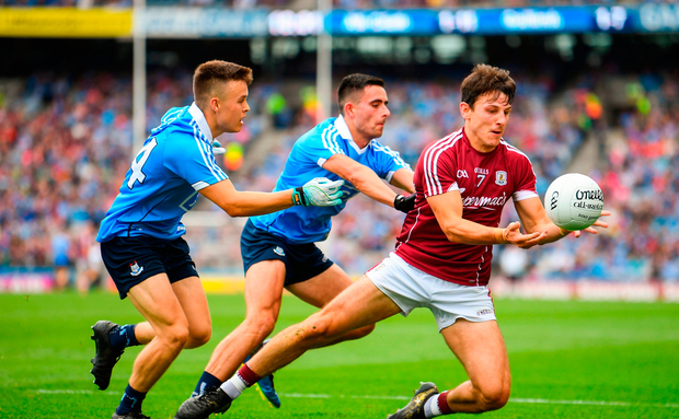 Seán Armstrong of Galway in action against Eoin Murchan, left, and Niall Scully
