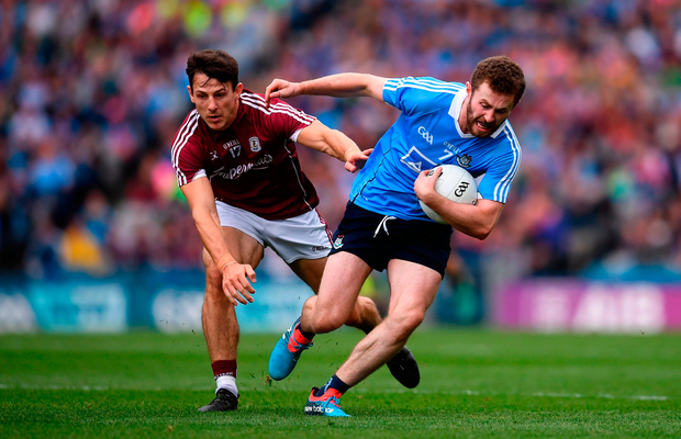 Jack McCaffrey of Dublin in action against Seán Armstrong of Galway during the GAA Football All-Ireland Senior Championship semi-final match between Dublin and Galway at Croke Park in Dublin.