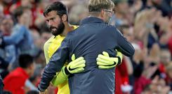 New Liverpool goalkeeper Alisson with manager Jurgen Klopp. Photo: Reuters
