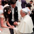 FAMILY FAITH: Wendy Grace and her husband Karl Melady meet Pope Francis in June 2014 at a Papal Audience in Rome. The Pope is due to arrive in Ireland on Saturday, August 25