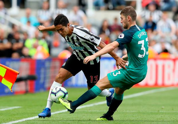 Tottenham's Ben Davies tackles Newcastle United's Yoshinori Muto during yesterday's Premier League match at St James' Park. Photo: Owen Humphreys