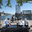 HOT PROPERTY: Workers take a lunch break in the shadow of the apartment blocks around Dublin's Grand Canal Dock. Photo: Tony Gavin