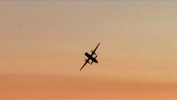 IN THE AIR: The twin-engine plane in mid-flight after it was stolen from Seattle-Tacoma airport. Photo: Getty Images