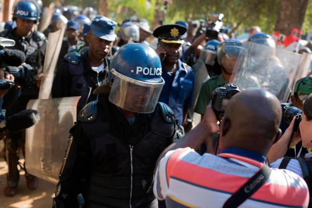 ELECTION CHAOS: Riot police enter the Bronte hotel, where a press conference by opposition leader Nelson Chamisa was scheduled to take place, in Harare, Zimbabwe. Photo: AP