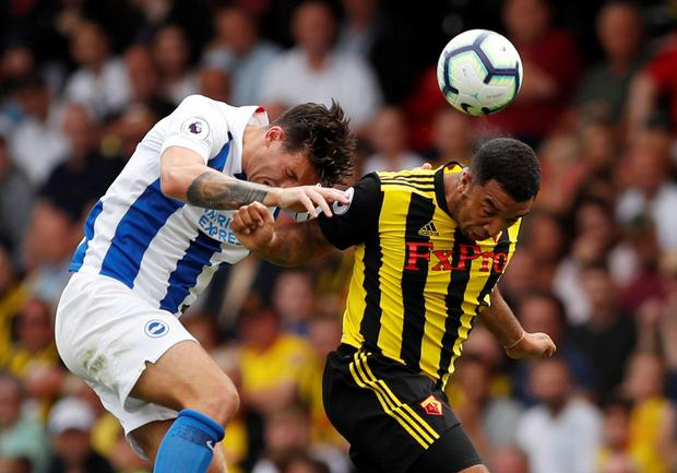 Watford's Troy Deeney rises with Brighton's Lewis Dunk. Photo: Reuters
