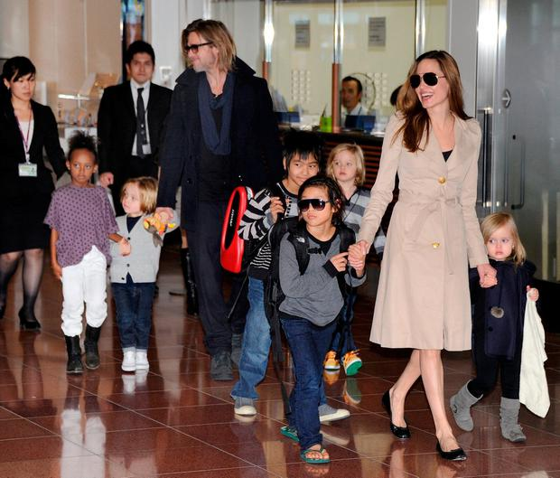 PLUS SIX: Back in 2011 when they were still a family, US movie stars Brad Pitt and Angelina Jolie appear with their six children in Haneda Airport in Tokyo. Photo: Toru Yamanaka/AFP/Getty