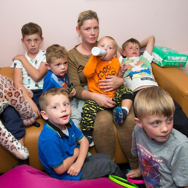 DISGRACE: Margaret Cash cried all night after her children (from left) Johnny (11), Rocky (2), Jim (4) Andy (1) Tommy (10) and Miley (7) were forced to sleep in Tallaght Garda Station