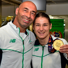 29 June 2015; Katie Taylor, Team Ireland, with her father and coach Pete Taylor on their return from the 2015 Baku European Games. Terminal One, Dublin Airport. Picture credit: Cody Glenn / SPORTSFILE