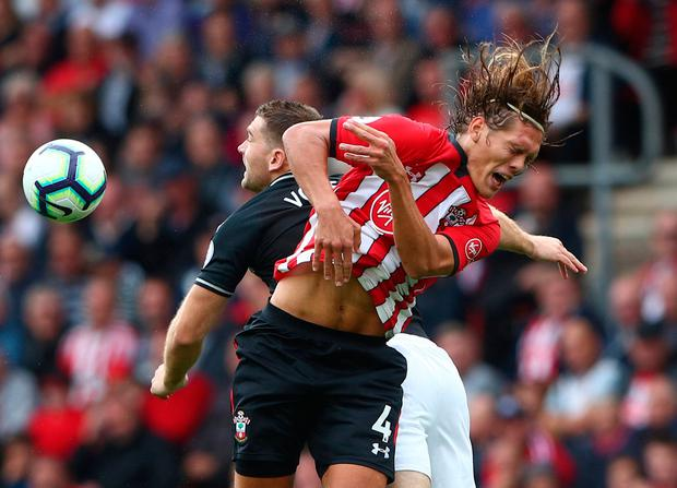 Soccer Football - Premier League - Southampton v Burnley - St Mary's Stadium, Southampton, Britain - August 12, 2018 Southampton's Jannik Vestergaard in action with Burnley's Sam Vokes REUTERS/Hannah McKay