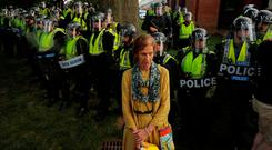 A counter-protester stands in front of state police at the University of Virginia in Charlottesville. Photo: Lucas Jackson/Reuters