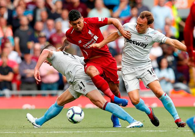 Liverpool's Roberto Firmino in action with West Ham's Declan Rice and Mark Noble. Photo: Andrew Yates/Reuters