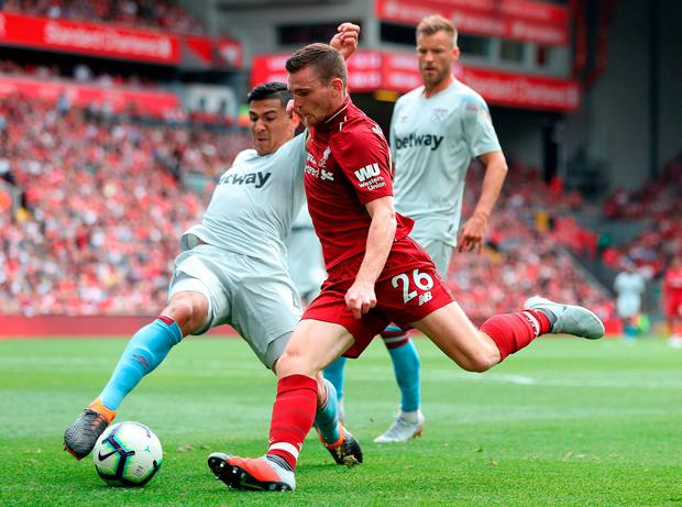 Liverpool's Andrew Robertson (right) in action with West Ham United's Fabian Balbuena. Photo: David Davies/PA Wire