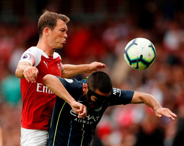 Arsenal's Stephan Lichtsteiner in action with Manchester City's Ilkay Gundogan. Photo: John Sibley/Action Images via Reuters