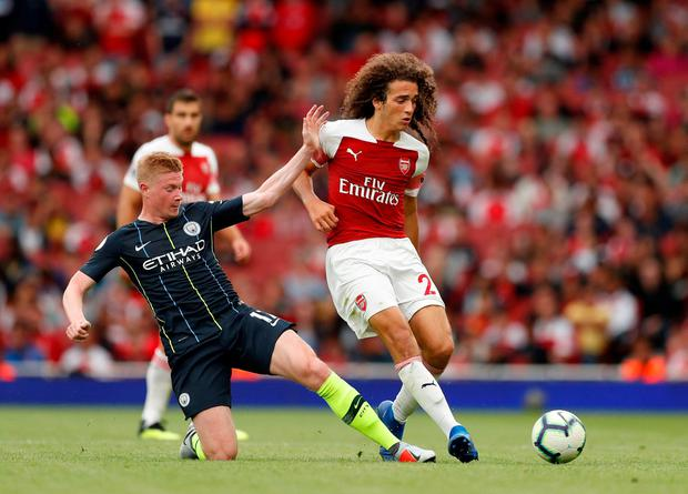 Arsenal's Matteo Guendouzi in action with Manchester City's Kevin De Bruyne. Photo: John Sibley/Action Images via Reuters