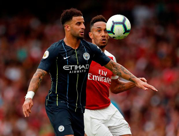 Manchester City's Kyle Walker in action with Arsenal's Pierre-Emerick Aubameyang. Photo: John Sibley/Action Images via Reuters