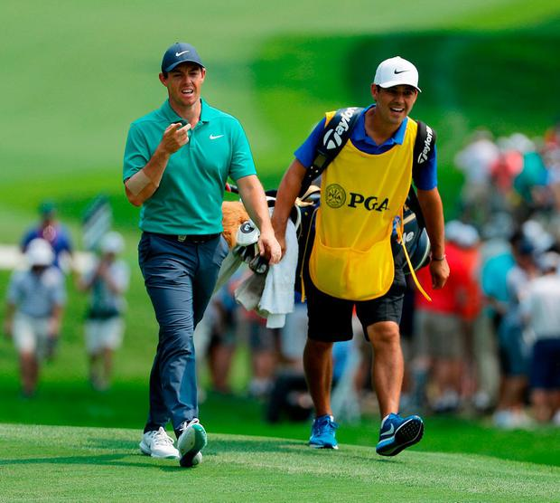 Rory McIlroy walks on to the ninth hole with caddie Harry Diamond during yesterday's final round of the PGA Championship. Photo: Richard Heathcote/Getty Images