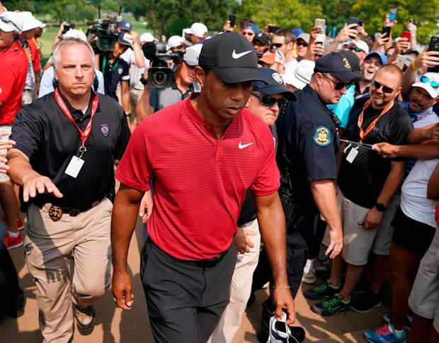 Fans follow Tiger Woods as he makes his way to the 10th tee-box during yesterday's final round of the USPGA Championship. Photo: Kyle Terada/USA Today Sports