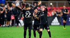 D.C. United midfielder Luciano Acosta (10) celebrates his goal with forward Wayne Rooney (9) and Yamil Asad (22)