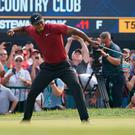 Tiger Woods celebrates a birdie putt on the 18th green during the final round of the PGA Championship. Photo: Jerry Lai-USA TODAY Sports