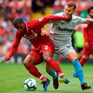 Liverpool's Georginio Wijnaldum (L) gathers possession from West Ham United's Jack Wilshere during their Premier League clash at the weekend. Photo: AFP/Getty Images