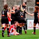 Kylie Murphy (centre) celebrates with Orlaith Conlon (No 3) and Katriona Parrock (25) after scoring a late winner for Wexford Youths against Linfield at Seaview yesterday. Photo: Oliver McVeigh/Sportsfile
