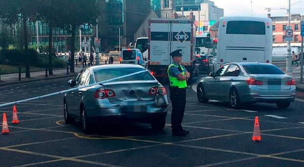 The silver Passat after being hit, bringing rush-hour traffic to a halt