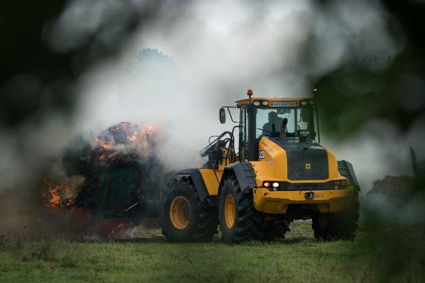 11/08/2018 A tractor drawing loads of burning hay from a hayshed which went on fire on a farm in Balla, Co. Mayo. Photo : Keith Heneghan