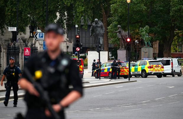 Auto crashes into security barriers outside Parliament: Armed police surround driver