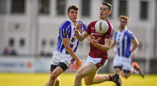 James Madden (left) tackles Dublin midfielder Brian Fenton during the Dublin County Senior Football Championship Group 1 match between Ballyboden St Enda's and Raheny back in April