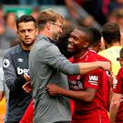 Liverpool's Daniel Sturridge celebrates with manager Juergen Klopp