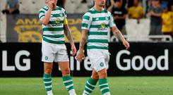 Celtic's Scott Brown and Leigh Griffiths look dejected after AEK Athens' Marko Livaja scored their second goal
